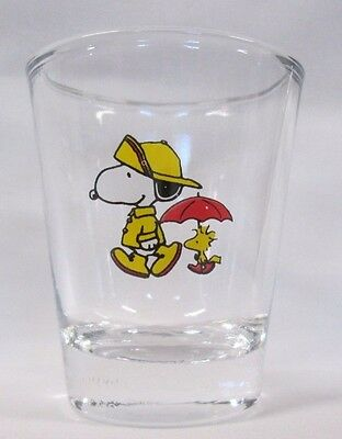 Snoopy in Raincoat, Woodstock with Umbrella Image on Clear Shot Glass