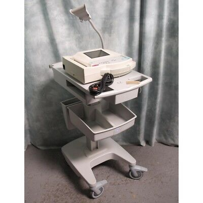 GE Marquette Microsmart MAC 1200 ECG Machine on trolley with leads