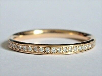 AN 18CT ROSE GOLD FULL CIRCLE RING WITH BEAUTIFUL WHITE G / Si1 DIAMONDS