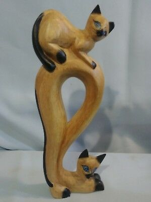 carved wood cats
