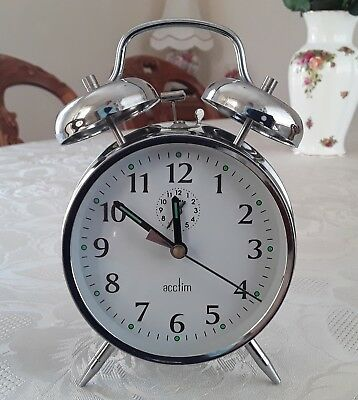 Acctim chrome metal wind-up  alarm clock with bells. In a good working condition