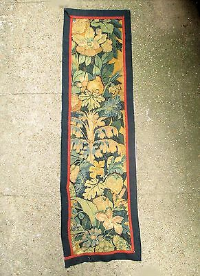 An Antique Tapestry Border with Fruits and Flowers
