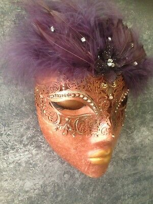 Wall hanging mask Masquerade theme with purple feathers