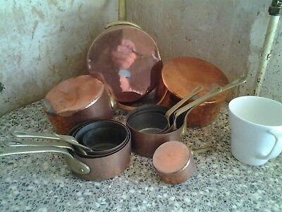 Copper saucepans with brass coloured handles, decorative only