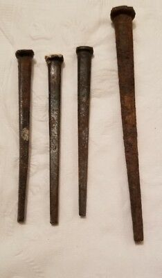 4 Antique Primitive Hand Forged Wrought Iron  Nails .