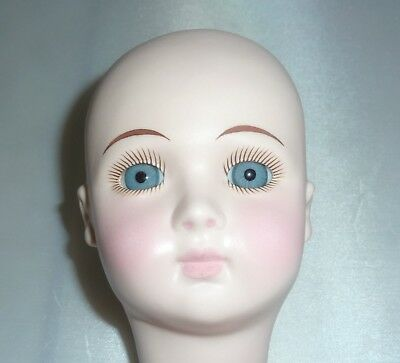 Porcelain Doll Head with Mounted Glass Eyes