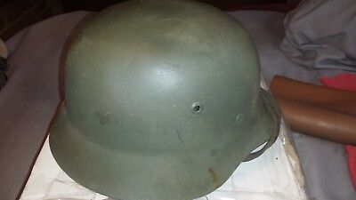 M 35 German helmet with liner and chinstrap.