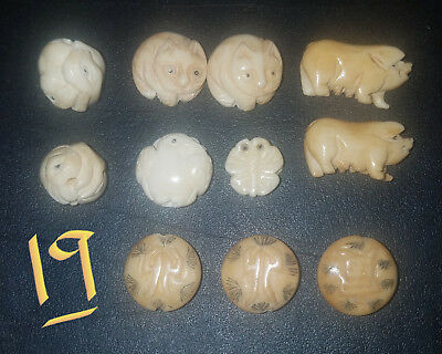 19.  (11) Bone, Carved Animal Buttons!!  Excellent Condition.. Unused!!