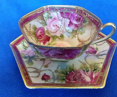 Gorgeous Nippon cup and saucer with gold moriage swags and roses. Excellent!!
