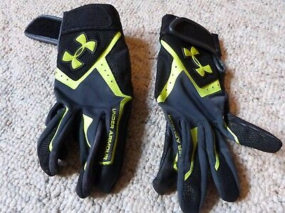 Under Armour youth baseball gloves size Medium, black and green