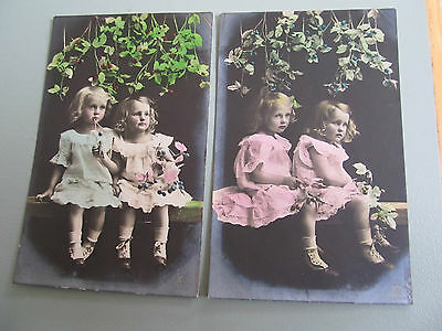 2 Antique real photo hand coloured postcards of pretty young girls on seat