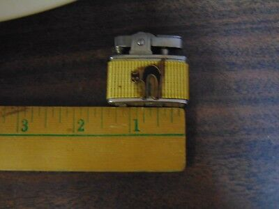 Small Edwin Lighter With Black Cat On Side Band On One Long Side