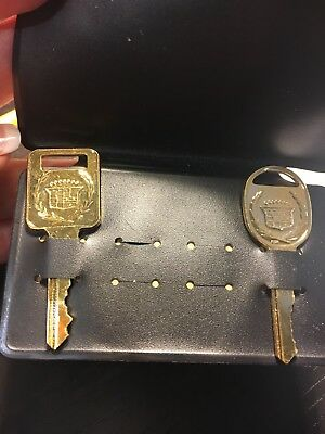Original Cadillac gold keys NOS E and H with crest wreath