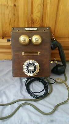 Vintage Telephone wooden with brass bells and bakelite handset.