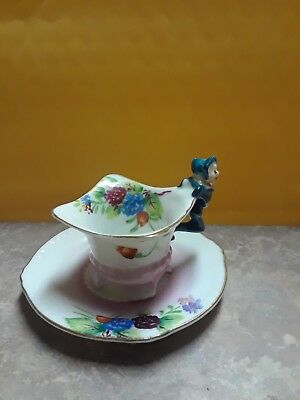 Demi Cup small Demi cup with figure on side with plate