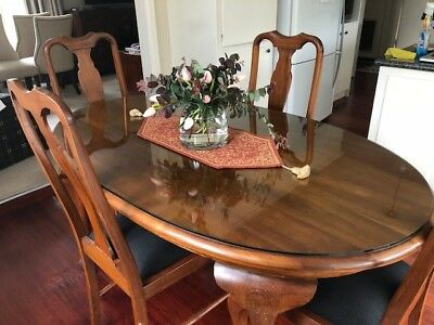 Early 20th Century Dining setting with chairs upholstered in Warwick fabric.