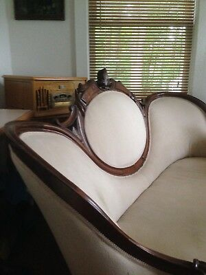Antique Balloon Back Settee in 1800's. This is hand carved oak.