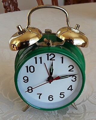 Green wind-up Alarm clock with bells in a good working condition.
