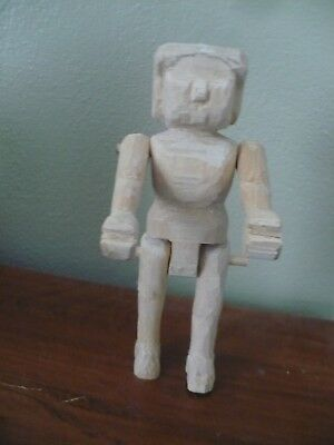 Half carved Hitty doll Waiting to be born