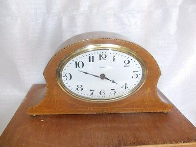 A Small Oval FacedFrench Mantel Clock Working. Sold As Spares Or Repair.