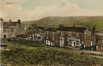 UK Reeth Grocery and Farmacy Shop in the middle and Hotel on the left postcard