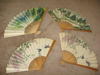 Lot of multiple decorative fans include wooden and metal base