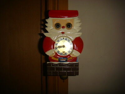 vintage father christmas clock with moveing eyes, mi-ken made in japan /repair