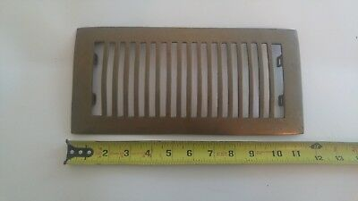 Art deco. Reclaimed brass grate vent. Rounded top. Very rare. Register