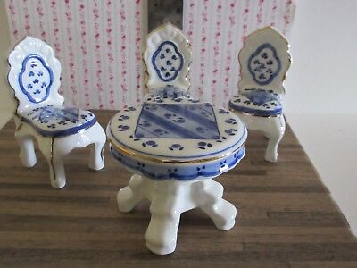 Miniature Dollhouse Ceramic Table and 3 chairs. White Ceramic with blue patterns