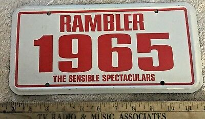 1965 Rambler The Sensible Spectaculars  Vintage Metal Dealer Plate Nos