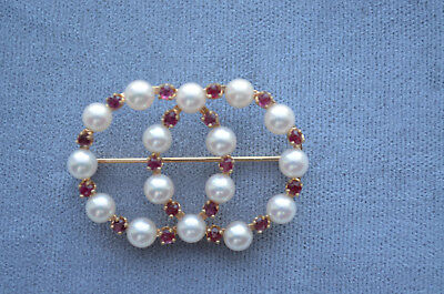 gold pearl ruby pin pendant in an integrated double circle design