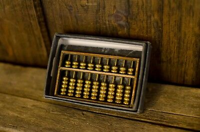 small vintage abacus green marble base brass Asian calculator