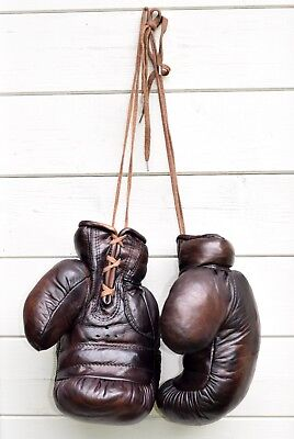 A pair of vintage style full size real leather display boxing gloves