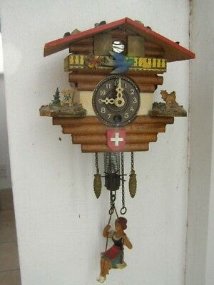 small Vintage Painted Swiss cuckoo clock Style with swinging lady &  Moving Bird