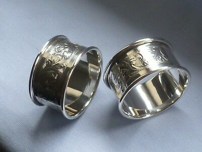 Pair of highly ornate Chester SOLID SILVER napkin rings with vacant cartouches
