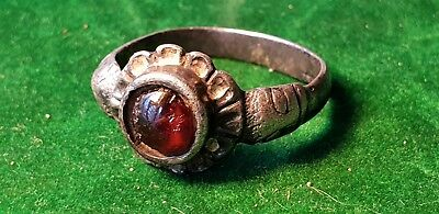 VIKING SILVER-GILT RING WITH BEAST HEADS AND CABOCHON 9TH-10TH century