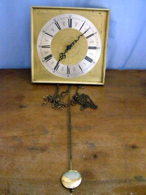 Old clock with pendulum for coins