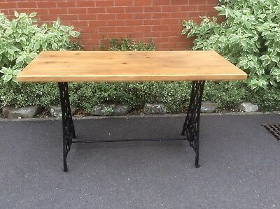 Table. Solid Pine table top with Cast Iron Singer Sewing Machine Legs.