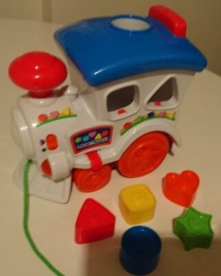 Shape sorter musical pull along train - with all shapes *excellent condition*
