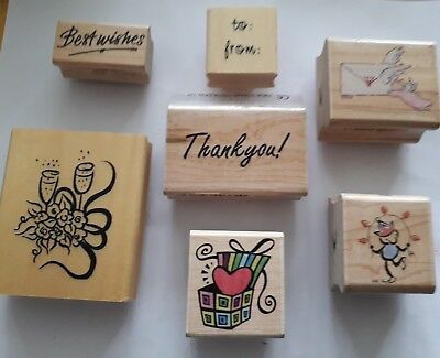 7 Assorted Wooden Rubber Stamps to include wedding, present, words.
