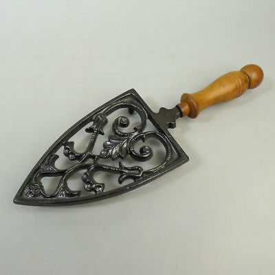 Victorian Cast Iron Decorative Trivet With A Turned Wood Handle