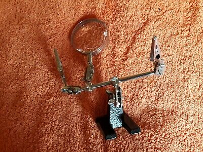Model maker's clamp with lens