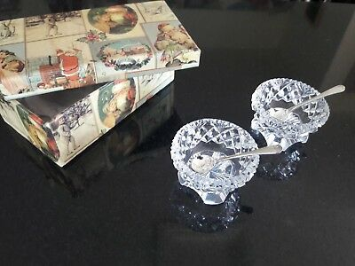 1840 Pair of Starburst cut footed open crystal salts with silver spoons