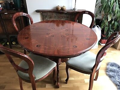 Round mahogany dining table and chairs