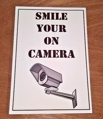 Security Camera warning sign laminated including sticky pads