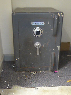 Large and heavy Chubb floor-standing safe. Door open and combination unknown!!