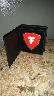 Firestone Tires Metal Emblem With Mounting Tape in a Book Type Box