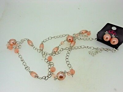 Pink necklace with matching earrings, New, never worn, original package+++