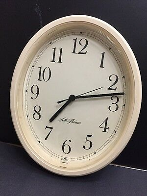 SETH THOMAS Oval Shaped Wall Time Clock Ivory Plastic Battery Powered