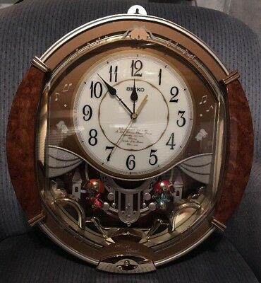 Seiko QXM118BRH Melodies In Motion Golden Puppets Swinging HiFi Sound Wall Clock